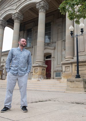 Daniel Mathuews stands in front of the Ross County Courthouse where a demonstration walk for LGBT+ solidarity took place earlier in July.