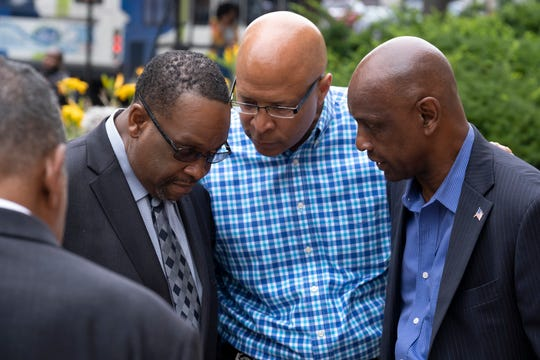 Bishop Bobby Hilton, left, Cincinnati Police Specialist Scotty Johnson, center, and State Sen. Cecil Thomas, right, meet in front of the Hamilton County Courthouse Monday July 22, 2019 after Judge Patrick Dinkelacker sentenced former judge Tracie Hunter on Monday July 22, 2019 to  a six-month jail sentence imposed upon her more than four years ago.  She had been allowed to remain out of jail while she pursued appeals in both state and federal court. But in May, a federal judge - after overseeing the case for three years without making a decision - said the sentencing can proceed.