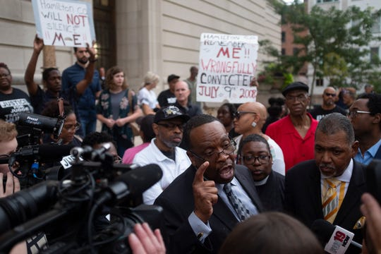 Bishop Bobby Hilton talks to the media in front of Hamilton County Courthouse Monday July 22, 2019 after Judge Patrick Dinkelacker sentenced former judge Tracie Hunter on Monday July 22, 2019 to  a six-month jail sentence imposed upon her more than four years ago.  Hunter had been allowed to remain out of jail while she pursued appeals in both state and federal court. But in May, a federal judge – after overseeing the case for three years without making a decision – said the sentencing can proceed.
