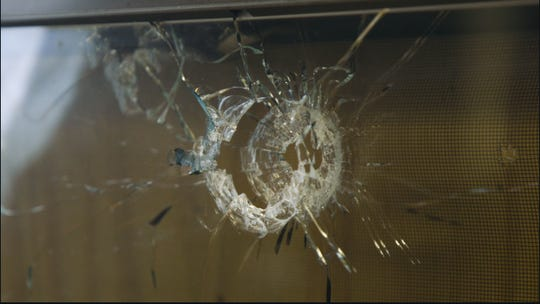 Multiple bullet holes riddle the walls and windows of Moneaca Collins' apartment in Winton Hills.