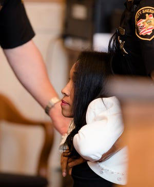 Former judge Tracie Hunter went limp and was dragged from the courtroom by a Hamilton County sheriff's deputy on Monday, July 22, 2019 after she was ordered to serve a six-month jail sentence imposed more than four years ago.