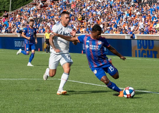 Allan Cruz (15) crosses the ball in the first half of the MLS soccer match between FC Cincinnati and New England Revolution on Sunday, July 21, 2019 in Cincinnati.