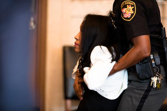 Former judge Tracie Hunter is taken into custody after her execution of sentence hearing by Hamilton County Common Pleas Judge Patrick T. Dinkelacker on Monday, July 22, 2019 in Cincinnati. Hunter was ordered to serve a six-month jail sentence that was imposed more than four years ago.