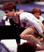 July 23, 1996: Kerri Strug of Houston, Texas, grimaces in pain after injuring her left leg following her landing on the vault rotation during the women's team gymnastics competition at the centennial Summer Olympic Games in Atlanta. Despite the injury, the U.S. won the gold in the team competition.