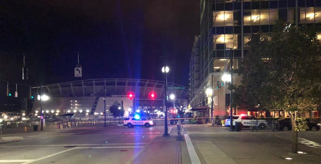 An argument between two men at a birthday party ended in a hail of gunfire with one of them shot in the leg at The Banks in downtown Cincinnati early Monday, Cincinnati police said.
