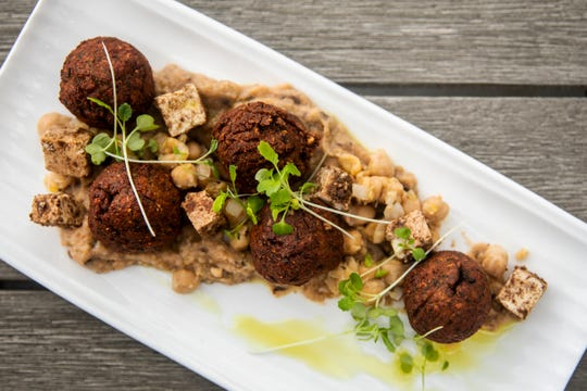 The View at Shires' Garden's vegetarian ribbeh includes falafel stuffed with spiced tofu and baba ghanoush, over a saute of garbanzo beans, apricot, eggplants and a touch of ras el hanout oil.
