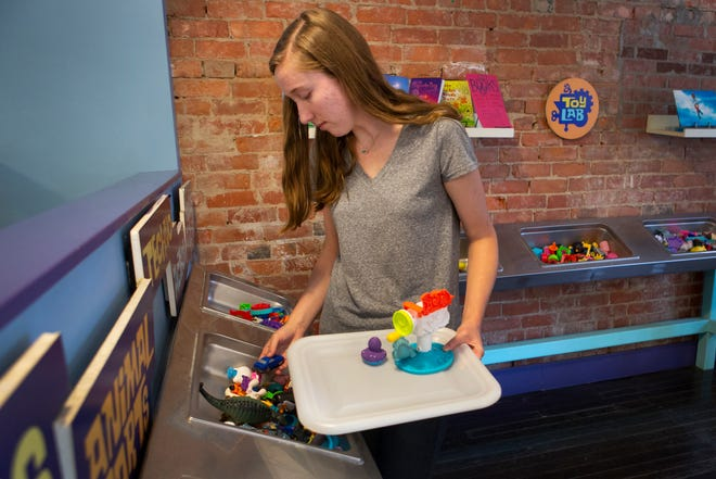 Rachel Berry picks parts out for her toy at the Happen's Toy Lab in Northside on Saturday, July 20, 2019.