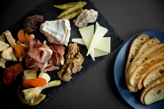 "The View at Shires' Garden's ""For the Table"" appetizer includes seasonal roulette, house pickles, rotating charcuterie, merguez, olive tapenade, trio of artisan cheeses, pepper jelly and house crostini."