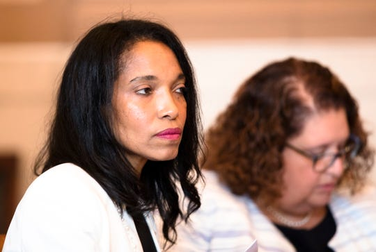 Former judge Tracie Hunter sits in the courtroom of Hamilton County Common Pleas Judge Patrick T. Dinkelacker on Monday. Hunter is expected to find out if she will be ordered to serve a six-month jail sentence that was imposed more than four years ago.