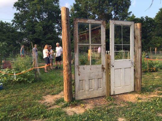 Doors are not only aesthetic, they serve as a gateway into the new Anderson community garden. Protective fencing surrounds the garden keeping it safe from hungry deer.