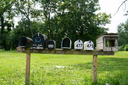 Mailboxes line Club House Drive in Latonia on Friday, July 19, 2019. Residents who live off Club House Drive do not have mail delivered at their houses and must use these and other mailboxes to receive their mail along this road. The Covington postmaster claims the roads are not safe for mail delivery even after the county and residents'$2 million investment in new roads. Trash and emergency response vehicles can make the trip down the roads.  The setup causes problems for elderly residents, frequent mail mix-ups and stolen packages.