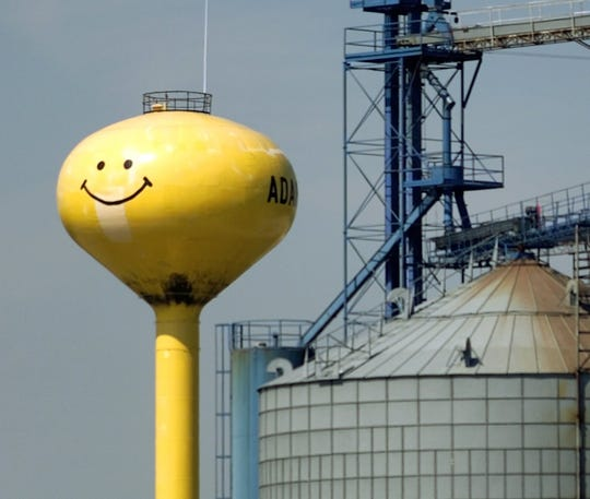 Adair's 250,000-gallon yellow water tower has two smiley faces painted on it. One smile beams east, the other west.