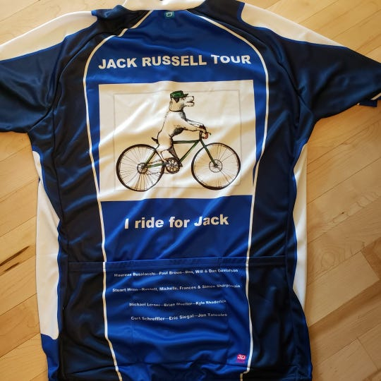 A close-up of the Jack Russell Tour team jersey. The Jack Russell Tour team is riding for Jack Gustafson, a Grinnell student who died from a medical accident while on study abroad in Germany.