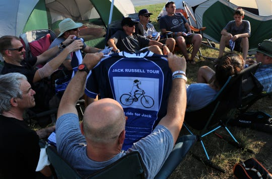 Members of the Jack Russell Tour team are gifted jerseys in remembrance of Jack Gustafson, a Grinnell student who died from a medical accident while on study abroad in Germany. They are riding RAGBRAI in his memory.
