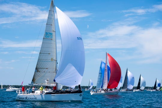 Ships release their spinnakers after starting in the 2019 Bayview Mackinac Race Saturday, July 20, 2019, on Lake Huron.