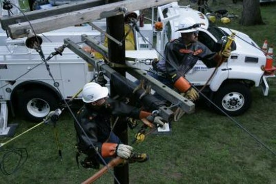 DTE Energy employees work on a power line in this file photo.
