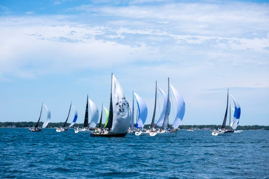 Ships release their spinnakers after starting in the 2019 Bell's Beer Bayview Mackinac Race Saturday, July 20, 2019, on Lake Huron.