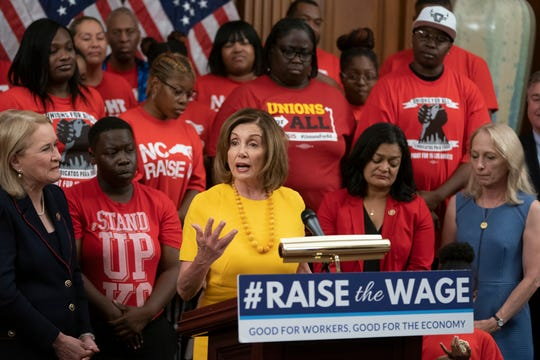 Speaker of the House Nancy Pelosi, D-Calif., joins fellow Democrats and activists  as the House approved legislation to raise the federal minimum wage for the first time in a decade, to $15 an hour, at the Capitol on July 18, 2019. The bill is expected to fail in the Republican-controlled Senate.