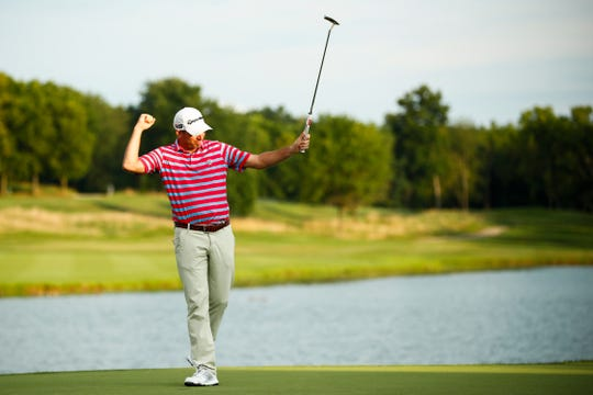 Jim Herman celebrates after winning the PGA Barbasol Championship in Nicholasville, Ky., on Sunday.