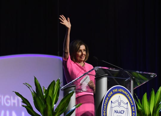 Speaker of the House Nancy Pelosi addresses conventiongoers at the NAACP gathering in Detroit on Monday.