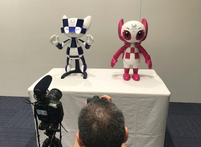 """Robots of mascots of Olympics """"Miraitowa,"""" left, and Paralympics """"Someity"""" shown at Toyota Motor Corp. headquarters in Tokyo."""