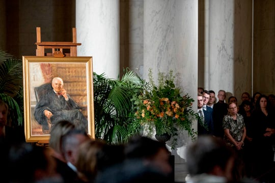 A portrait of the late Supreme Court Justice John Paul Stevens is displayed as he lies in repose during a private ceremony in the Great Hall of the Supreme Court in Washington, Monday, July 22, 2019.