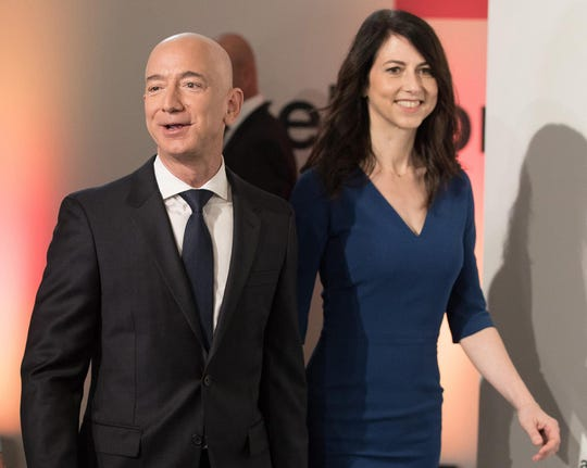 Amazon CEO Jeff Bezos and his wife, MacKenzie Bezos, arrive for the Axel Springer award ceremony on April 24, 2018, in Berlin.