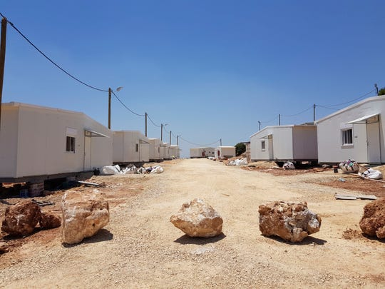 This Tuesday, July 7, 2019 photo shows the general view of a a settlement outpost Neve Achi, named by Peace Now as one of the dozens of outpost Israeli authorities have retroactively legalized dozens in the West Bank, a growing number of which have been founded since President Donald Trump entered office.