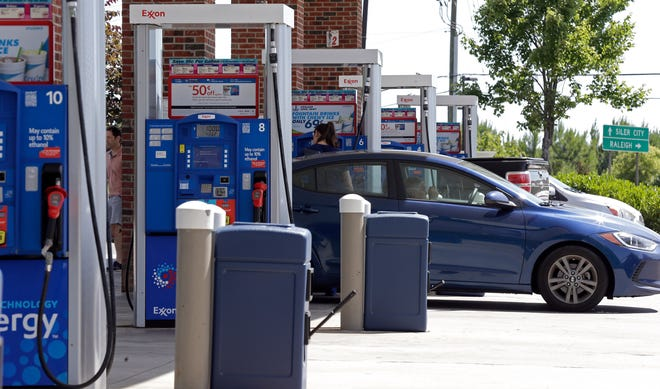 This photo taken Wednesday, June 26, 2019 shows cars refueling at a gas station in Pittsboro, N.C.