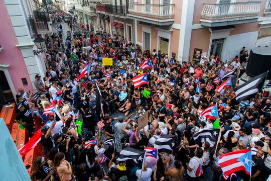 Demonstrators protest against Gov. Ricardo Rossello in San Juan, Puerto Rico, Sunday, July 21, 2019.
