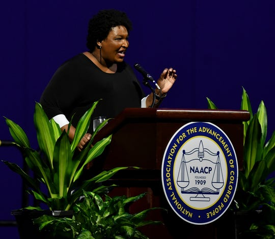 Stacey Abrams gives the keynote address at the Clarence M. Mitchell Jr. Memorial Luncheon at the NAACP's convention at Cobo Center in Detroit on Monday.