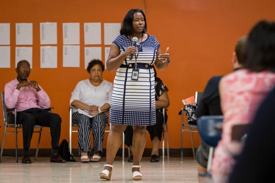 Interim superintendent Patricia Robinson addresses parents, community members, and district staff as board members look on during a Parent and Community Forum for Benton Harbor Area Schools on July 18. People could ask questions, enroll their child for school, and get updates.
