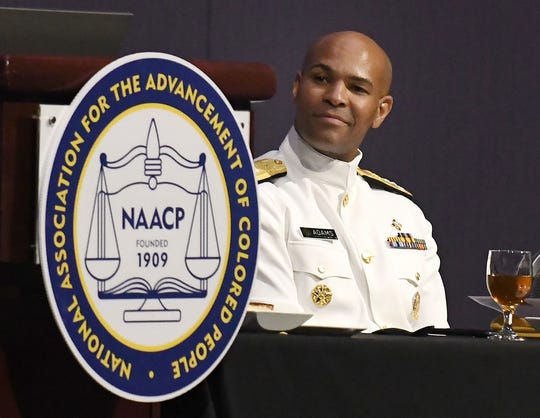 U.S. Surgeon General Jerome Adams waits for his introduction Monday at the 110th NAACP Convention at Cobo Center.