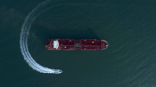 In this Sunday, July 21, 2019 photo, an aerial view shows a speedboat of Iran's Revolutionary Guard moving around the British-flagged oil tanker Stena Impero which was seized in the Strait of Hormuz on Friday by the Guard, in the Iranian port of Bandar Abbas.