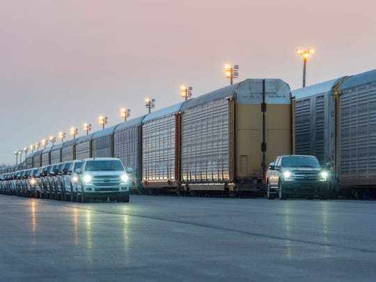 Linda Zhang, chief engineer of the Ford F-150, shows the capability of a prototype all-electric F-150 by towing 10 double-decker rail cars and 42 2019-model year F-150s, weighing more than 1 million pounds.