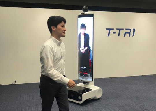 The T-TR1 is a moving human-size display designed to represent people who can't be there.