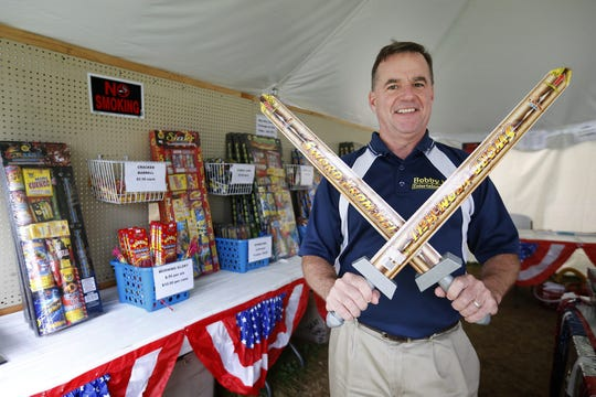Bob Kramarik, founder of Bobby K Entertainment, shows off the Swords from Hell fireworks under the Bobby K Entertainment fireworks tent at 81 Canal St. in Big Flats in 2015.