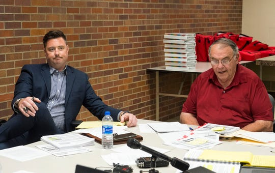 Republican City Council candidate Alex Schmitt, left, listens to testimony from Vanderburgh County Republican Party Chairman Wayne Parke, right, to Vanderburgh County Election Board Monday, July 22, 2019. The board fined Schmitt the maximum $100 for improper reporting of campaign contributions and expenditures in 2016 when he ran for County Council.