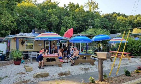 Fun seekers at the Blue River stop at the Blue River Landing for dinner on Saturday, July 20, 2019.