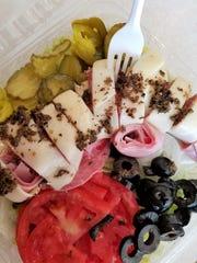 A Siciliano salad from Siciliano Subs, with ham, hot capicola, and genoa salami.