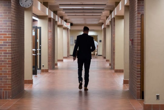 Republican City Council candidate Alex Schmitt walks down the a hall of the Civic Center after the Vanderburgh County Election Board heard a complaint that his failure to account for his expenditure of more than $20,000 in 2016 campaign donations is a violation of Indiana election law Monday, July 22, 2019. Schmitt was fined $100.