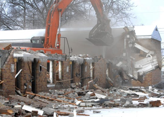 BOB GWALTNEY / Courier & Press Workers began demolishing the Erie Homes Wednesday, February 13, 2008. It is expected it to take two months complete the project. The public housing home were built in 1954 and are located at Lincoln Avenue and Governor Street.