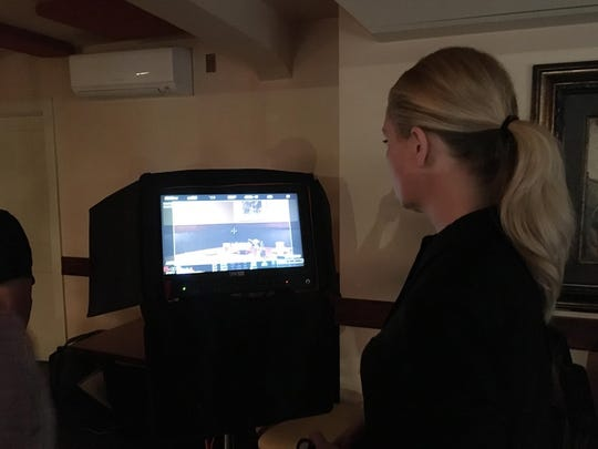 Director Ryann Liebl checks over lightning and space for the upcoming scene. Her crew shot at Trattoria Stefano on July 21, 2019.