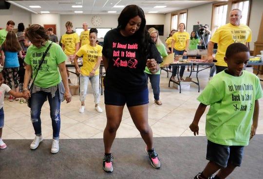Heaven Daniels, center, leads a dance at the Daniels Back to School Bash Monday at Spring Lake Church.