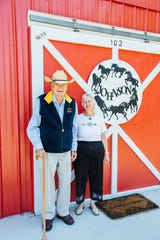 Marga Johnson and her late husband, Reidar, stand by their renovated private event barn. The Johnsons were early boosters for the festival and house planning parties and other activities for the festival.