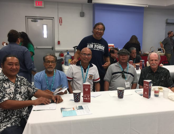 """Guam veterans reunion:  Military veterans from Agat reunited at the annual VA health conference  """"Staying Strong"""" held at the GCC Multi-purpose Auditorium on July 18. Pictured from left: Teodore Nededog, Richard Aguigui, Alejo Sablan, Raymond Salas (standing) Ricardo Sablan, and Forrest Harris."""