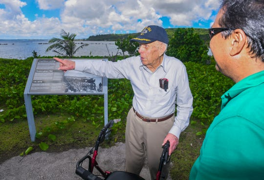 Raymond Faulkner, 97, points out towards the offshore reef line during a visit to the War In The Pacific National Historical Park Guam - Asan Unit with independent tour guide, Ronald T. Laguana, on July 22, 2019. The World War II veteran recalled memories of coming ashore, as a younger Marine 75 years ago, during the liberation of Guam from the occupation of Imperial Japanese Forces.