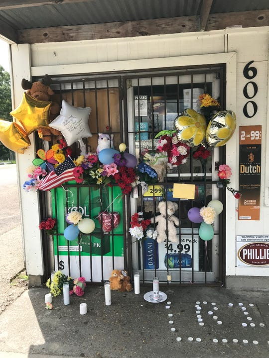 Supporters of Lisa Nguyen and her family brought balloons, flowers and other mementos to the store in support of the woman who was murdered during an armed robbery at Steelman Grocery on Saturday, July 20, 2019.