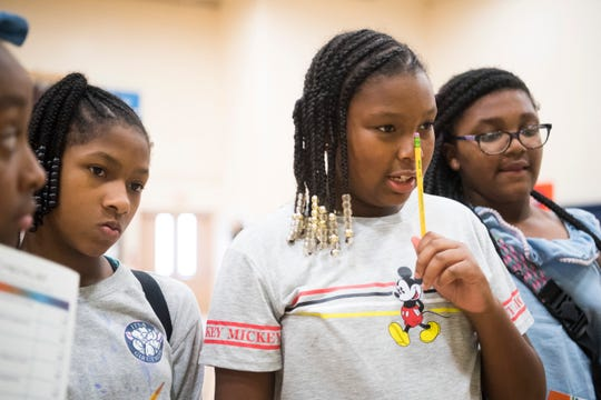 With a pencil to her nose, Maliyah Queemer thinks about the cost of utilities as students learn about personal finance while attending Freedom School at Sarah Moore Greene Magnet Academy in East Knoxville on Monday, July 22, 2019. Students were given a career, salary and family situation, and were asked to budget for life expenses.