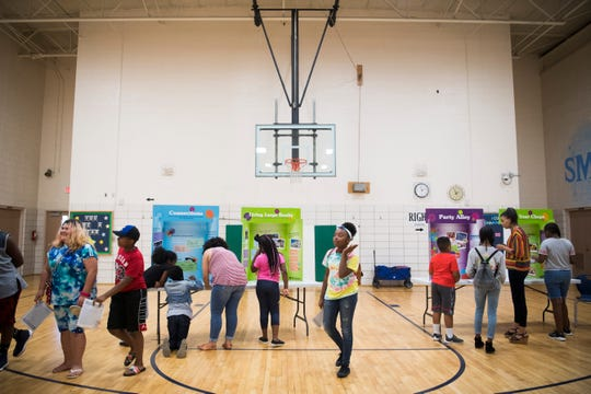Students mingle as they learn about personal finance while attending Freedom School at Sarah Moore Greene Magnet Academy in East Knoxville on Monday, July 22, 2019. Students were given a career, salary and family situation, and were asked to budget for life expenses.